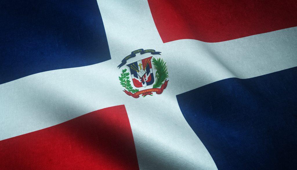 A closeup shot of the waving flag of Dominican Republic with interesting textures. A closeup shot of the waving flag of Dominican Republic with interesting textures.